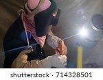 welder testing welding at... | Shutterstock . vector #714328501
