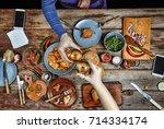 meeting friends at the dinner...   Shutterstock . vector #714334174