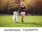 pretty girl playing and running ... | Shutterstock . vector #714334975
