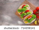holder with delicious fish... | Shutterstock . vector #714358141