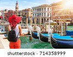 female tourist with map in her... | Shutterstock . vector #714358999