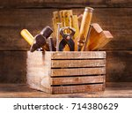 old tools in a wooden box on... | Shutterstock . vector #714380629