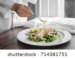 female chef pouring sauce onto...   Shutterstock . vector #714381751