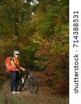 mountain biking down the trail. ... | Shutterstock . vector #714388531