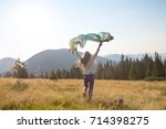 happy teenage girl runs along...   Shutterstock . vector #714398275