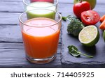 fresh juices in glasses with... | Shutterstock . vector #714405925