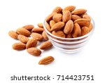 Small photo of Almond. Almond nut isolated. Almond slice. Full depth of field.