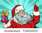 santa claus with gift. new year ... | Shutterstock .eps vector #714424555