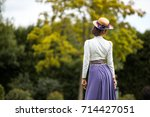beautiful girl in a vintage... | Shutterstock . vector #714427051