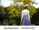 beautiful girl in a vintage... | Shutterstock . vector #714427051