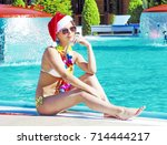 happy woman at a pool christmas ... | Shutterstock . vector #714444217