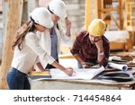 two female  inspectors and... | Shutterstock . vector #714454864