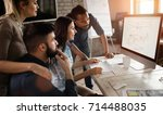 group of young designers... | Shutterstock . vector #714488035