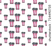 vector pink wellies with blue... | Shutterstock .eps vector #714490735