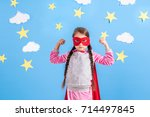 six year blonde girl dressed... | Shutterstock . vector #714497845