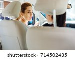 positive delighted women... | Shutterstock . vector #714502435