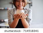 Smiling Woman Showing Clay Cup...