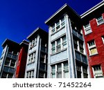 Apartment building with blue sky - stock photo