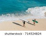 Two Surfer Girls In Swimwear...