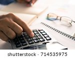 hand woman doing finances and... | Shutterstock . vector #714535975