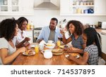 family with teenage children... | Shutterstock . vector #714537895