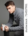 sexy young man in warm knit... | Shutterstock . vector #714537901