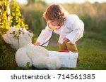 adorable little girl role... | Shutterstock . vector #714561385
