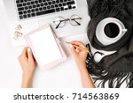 woman holding a empty card.... | Shutterstock . vector #714563869