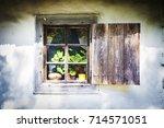 village house window decorated...   Shutterstock . vector #714571051