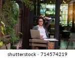 tired businesswoman having a... | Shutterstock . vector #714574219