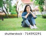 teenage girl sitting in the... | Shutterstock . vector #714592291