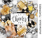 card with word cheers with... | Shutterstock . vector #714594001