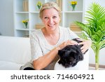 grandmother with a dog | Shutterstock . vector #714604921