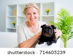 grandmother with a dog | Shutterstock . vector #714605239