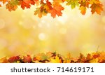 autumn background with maple... | Shutterstock . vector #714619171