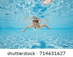 happy young boy swim and dive... | Shutterstock . vector #714631627