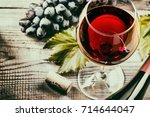 red wine and grapes. wine and... | Shutterstock . vector #714644047