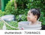 children play and bathed water... | Shutterstock . vector #714646621