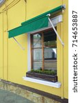 window with green awning   Shutterstock . vector #714653887