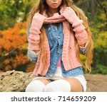 woman posed outdoor dressed in