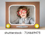 child playing with cardboard... | Shutterstock . vector #714669475