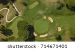 aerial of a golf course with... | Shutterstock . vector #714671401