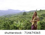 Small photo of a woman with sarangi on the mountain