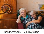 an elderly woman with her adult ... | Shutterstock . vector #714699355