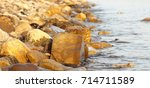 the sea in the autumn at sunset ... | Shutterstock . vector #714711589