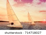 two sailboats at sunset.... | Shutterstock . vector #714718027