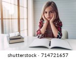 little cute girl is bored and... | Shutterstock . vector #714721657