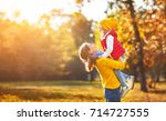 happy family mother and child... | Shutterstock . vector #714727555
