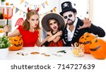 a happy family in costumes... | Shutterstock . vector #714727639