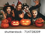 Stock photo happy family mother father and children in costumes and makeup on a celebration of halloween 714728209